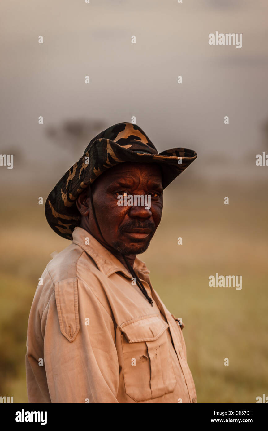 2949ee3bee2 Male African safari guide poses for a portrait in bush hat in Okavango  Delta