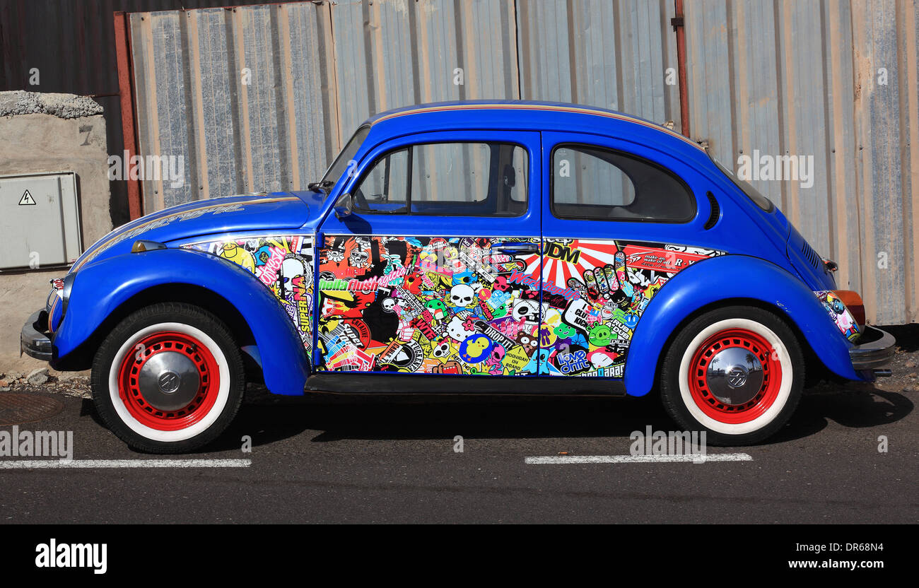Blue VW Beetle with lots of stickers, Lanzarote, Canary islands, canaries, spain - Stock Image