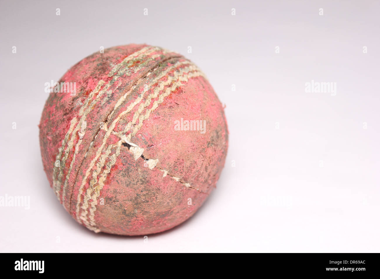 A worn out cricket ball Stock Photo