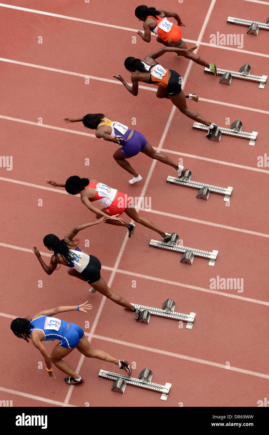 Out of the Starting Blocks in the Women's 100 Yard Dash Heat at the Penn Relays Carnival in Philadelphia, Pennsylvania. - Stock Image