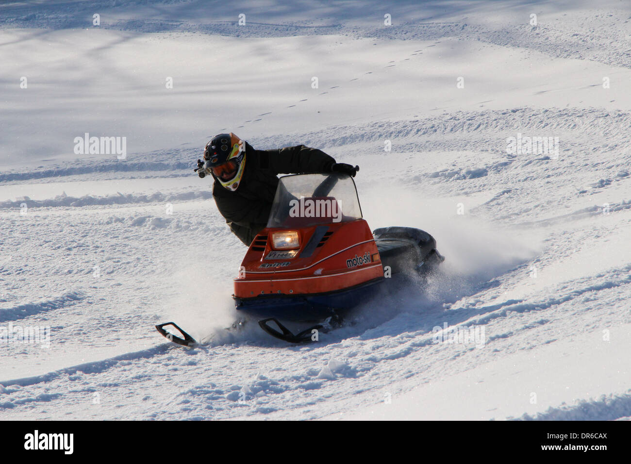 A man rides a snowmobile in Northern Quebec - Stock Image