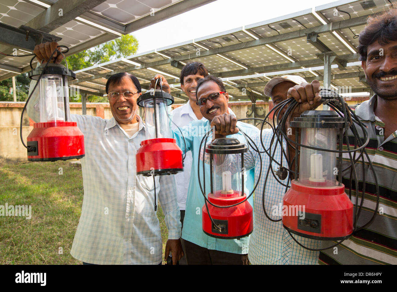 A WWF project to supply electricity to a remote island in the Sunderbans, a low lying area of the Ganges Delta in Eastern India, that is very vulnerable to sea level rise. Prior to this project the subsistence farmers had no access to electricity. This shot shows villagers with their new solar lanterns. Before instalation of the solar panels they had to burn kerosene for lighting. - Stock Image