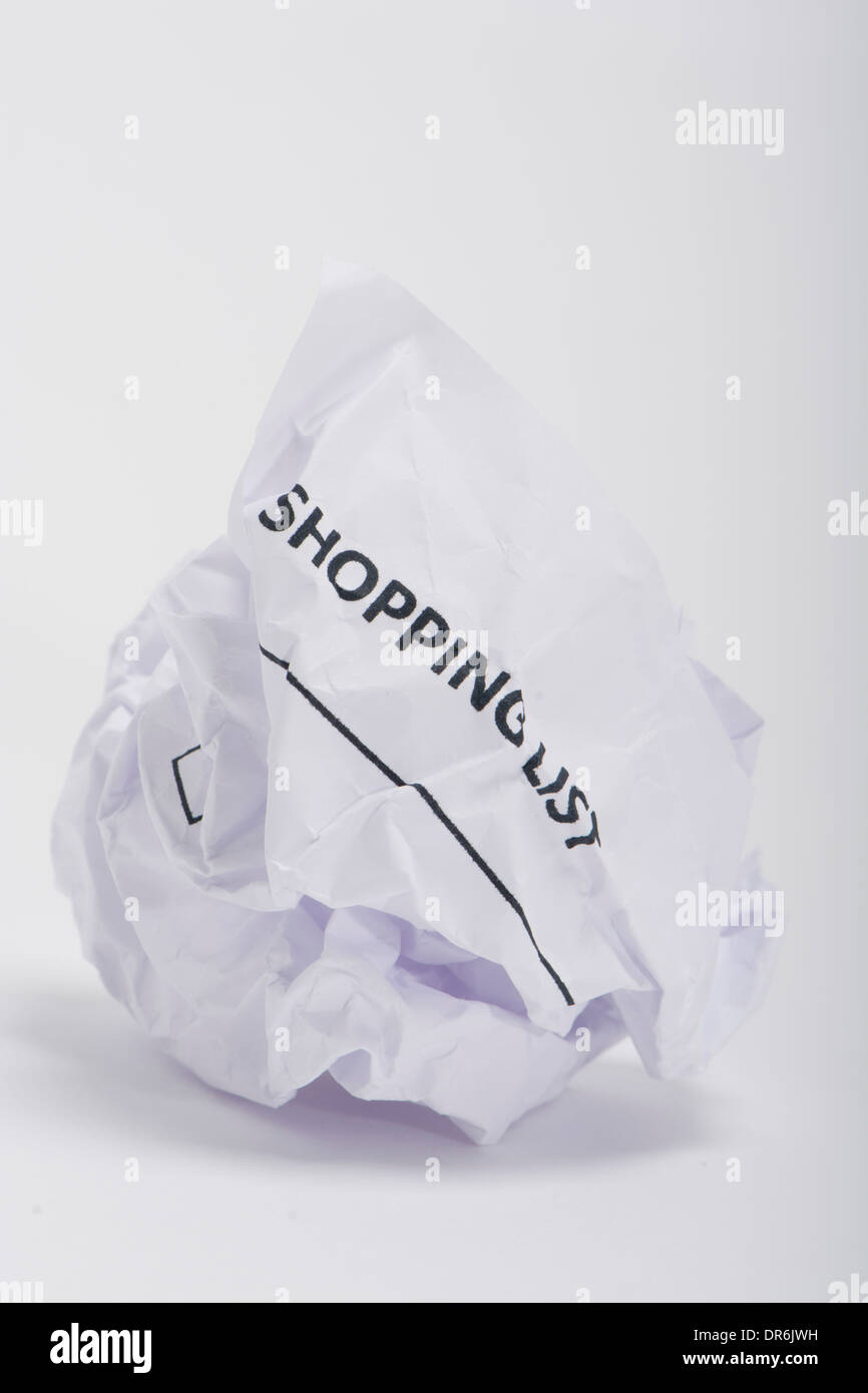 a shopping list on a crumpled ball of paper stock photo: 65914733