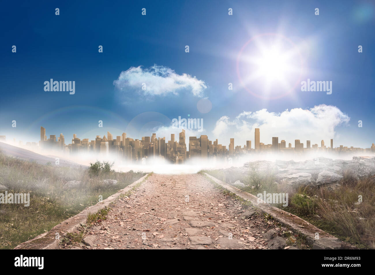 Stony path leading to large urban sprawl under the sun - Stock Image