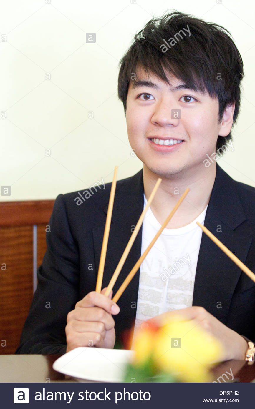 Close-up of Lang Lang having lunch 12 june 2012 Stock Photo