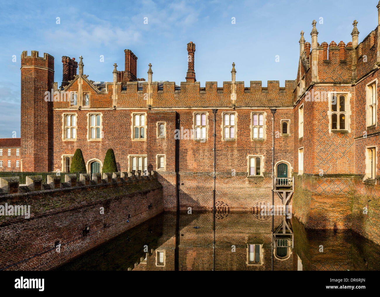 London, UK, 20th January,2014. The dry moat at Hampton Court Palace contains water after the recent heavy rains. The dry moat contains the lights that illuminate the front of the Palace and visitors are enjoying the unusual sight of a water-filled moat. Credit:  Eden Breitz/Alamy Live News - Stock Image
