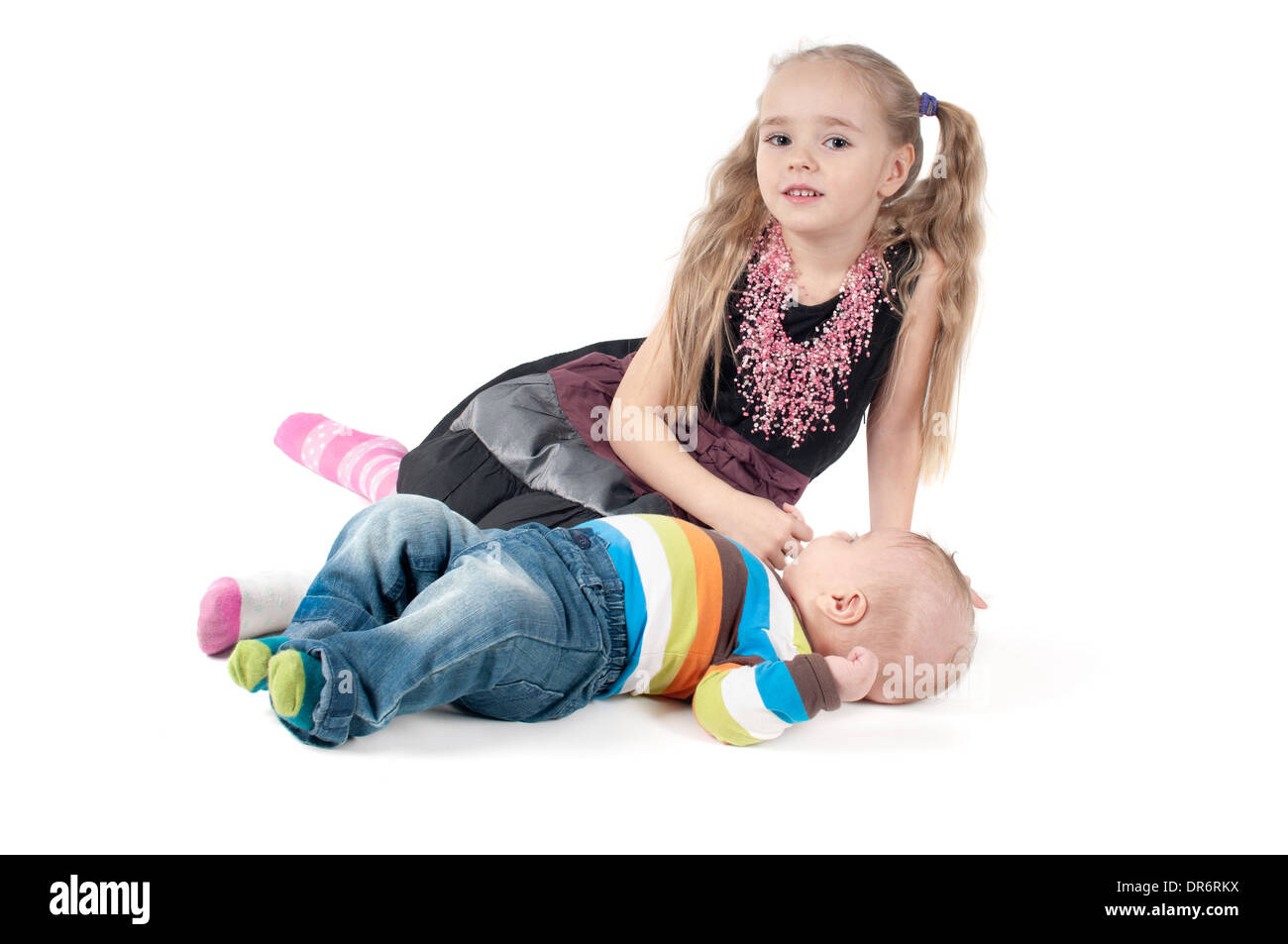 Newborn baby with sister - Stock Image