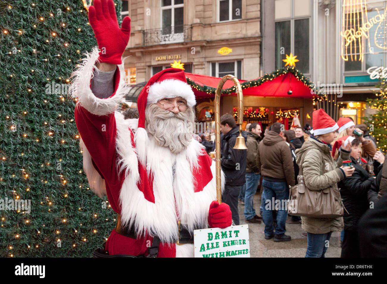 Santa Claus At The Entrance To Cologne Christmas Market Cathedral Koln Germany Europe
