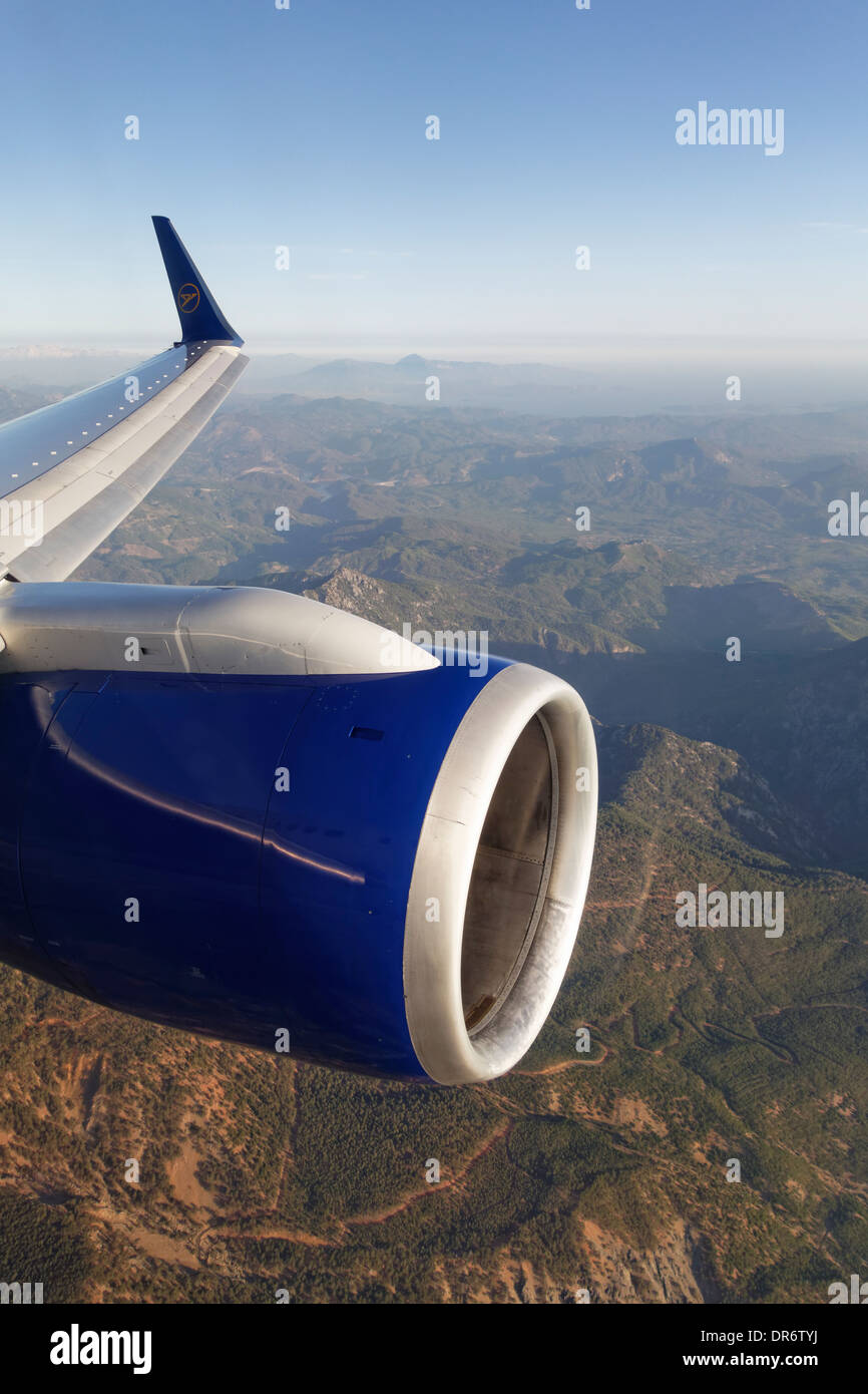Turkey, Wing and jet engine of a plane above mountains - Stock Image