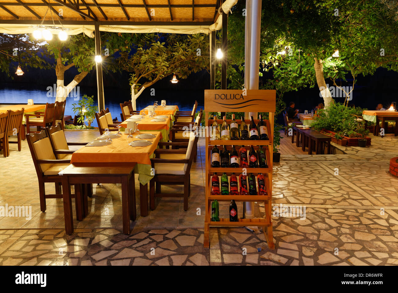 Turkey, Province Mugla, Laid tables in a restaurant at Dalyan River - Stock Image