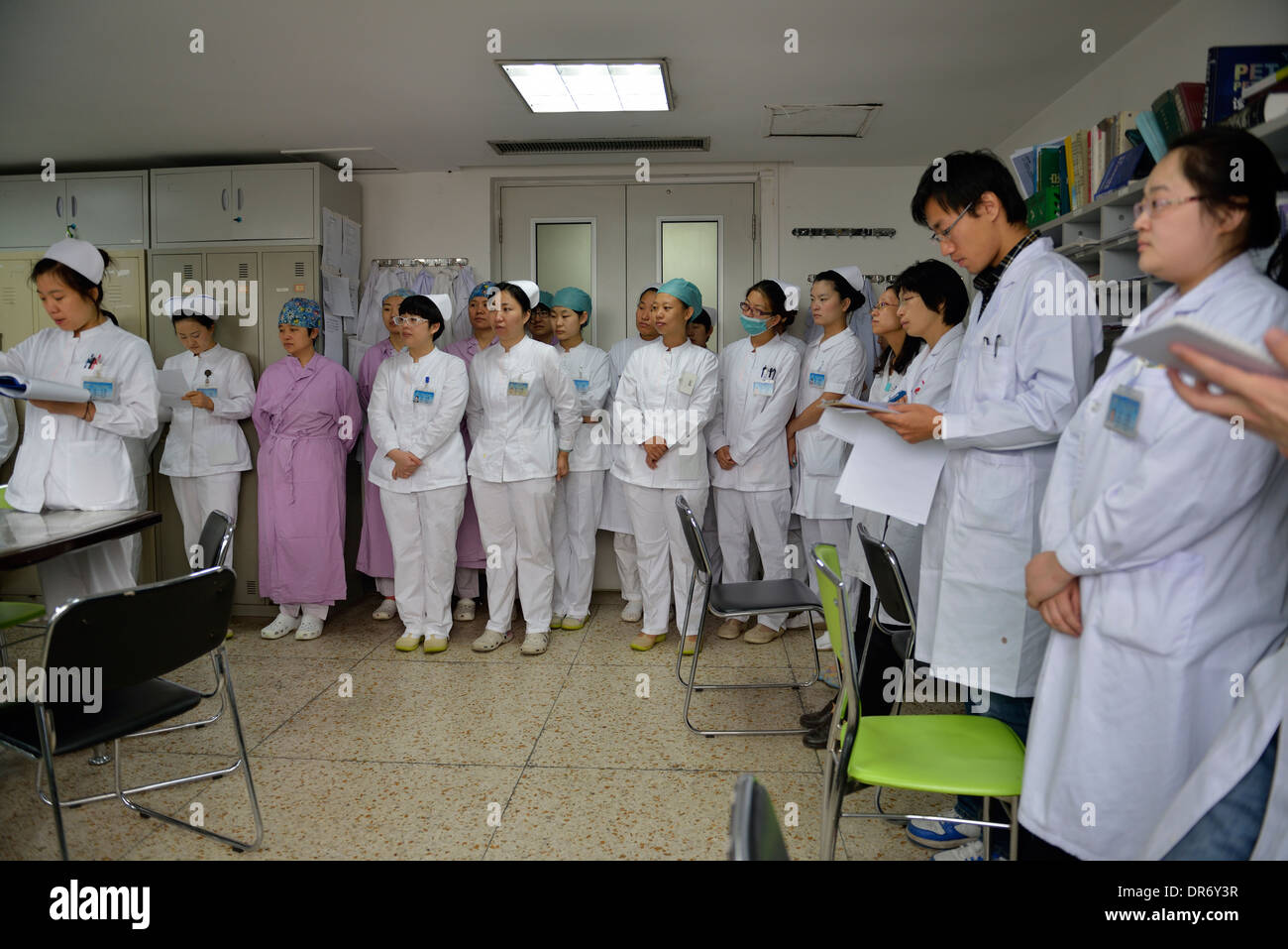Doctors and nurses daily shift meeting in Beijing Cancer Hospital. 18-Oct-2013 - Stock Image