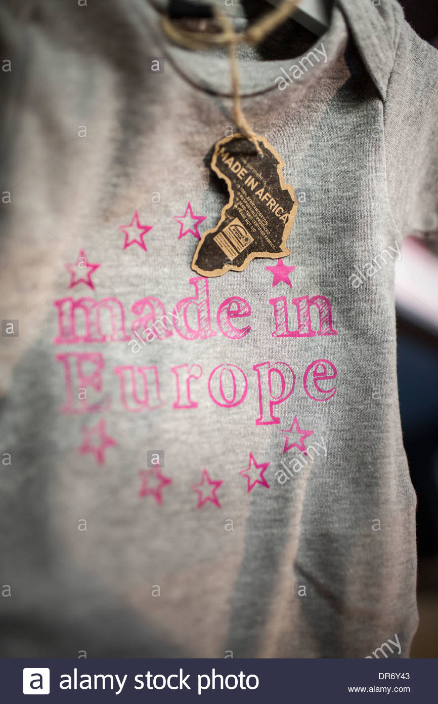 Close-up of a babygro in a store - Stock Image