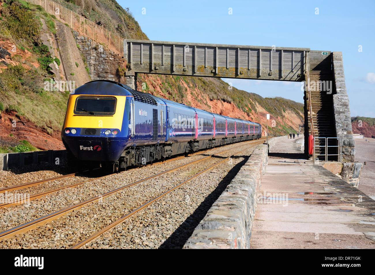 First Great Western class 43 HST by the coastal sea wall near Dawlish, Devon, England, UK - Stock Image