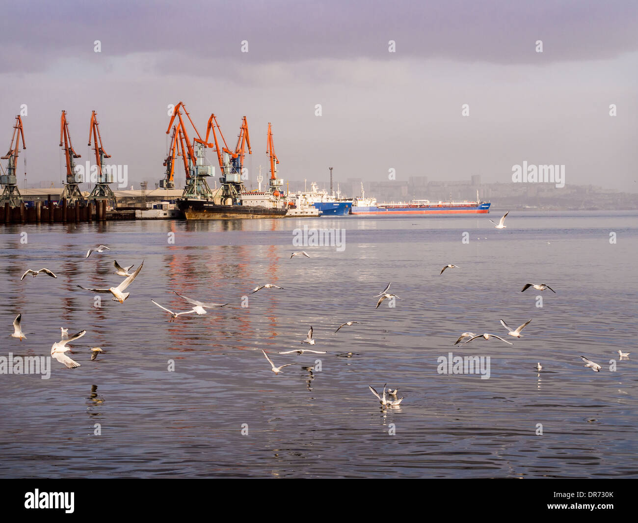 Baku International Marine Trade Port at sunset. - Stock Image
