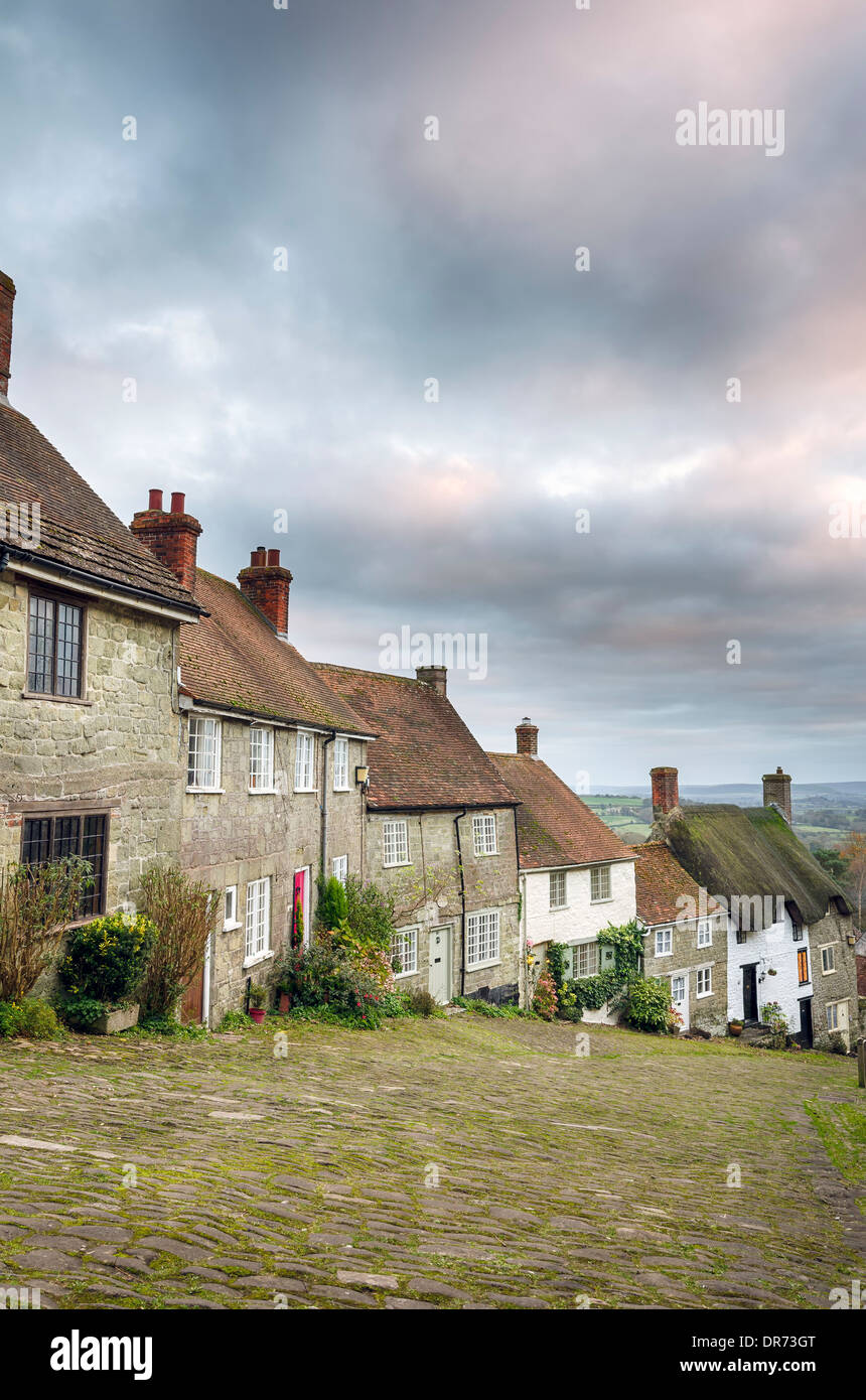 A row of quaint English cottages at Gold Hill in Shaftesbury, Dorset - Stock Image