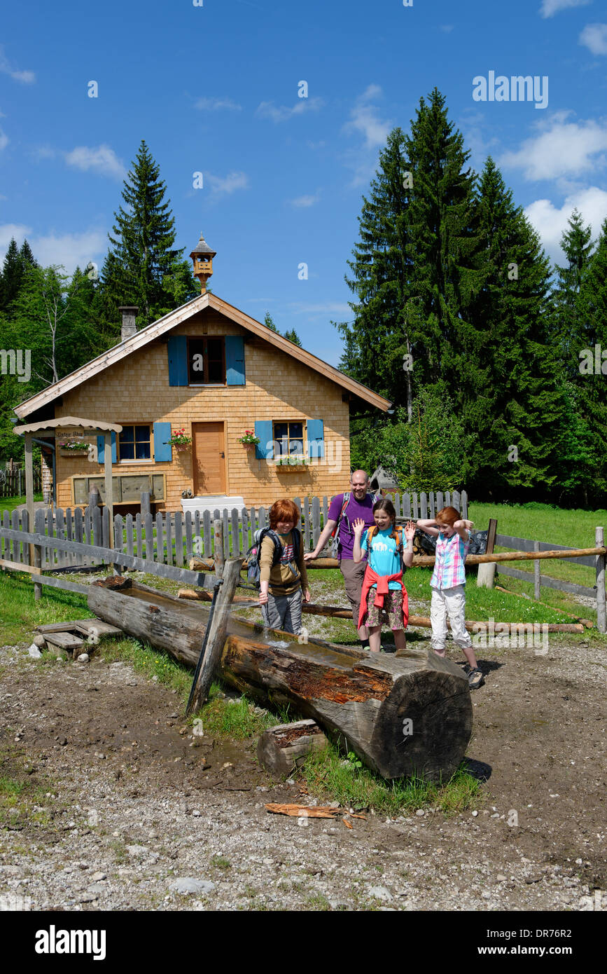 Germany, Bavaria, Familiy hiking and playing with water, Lower Alp at the way to the Kappeler Alp near Nesselwang - Stock Image