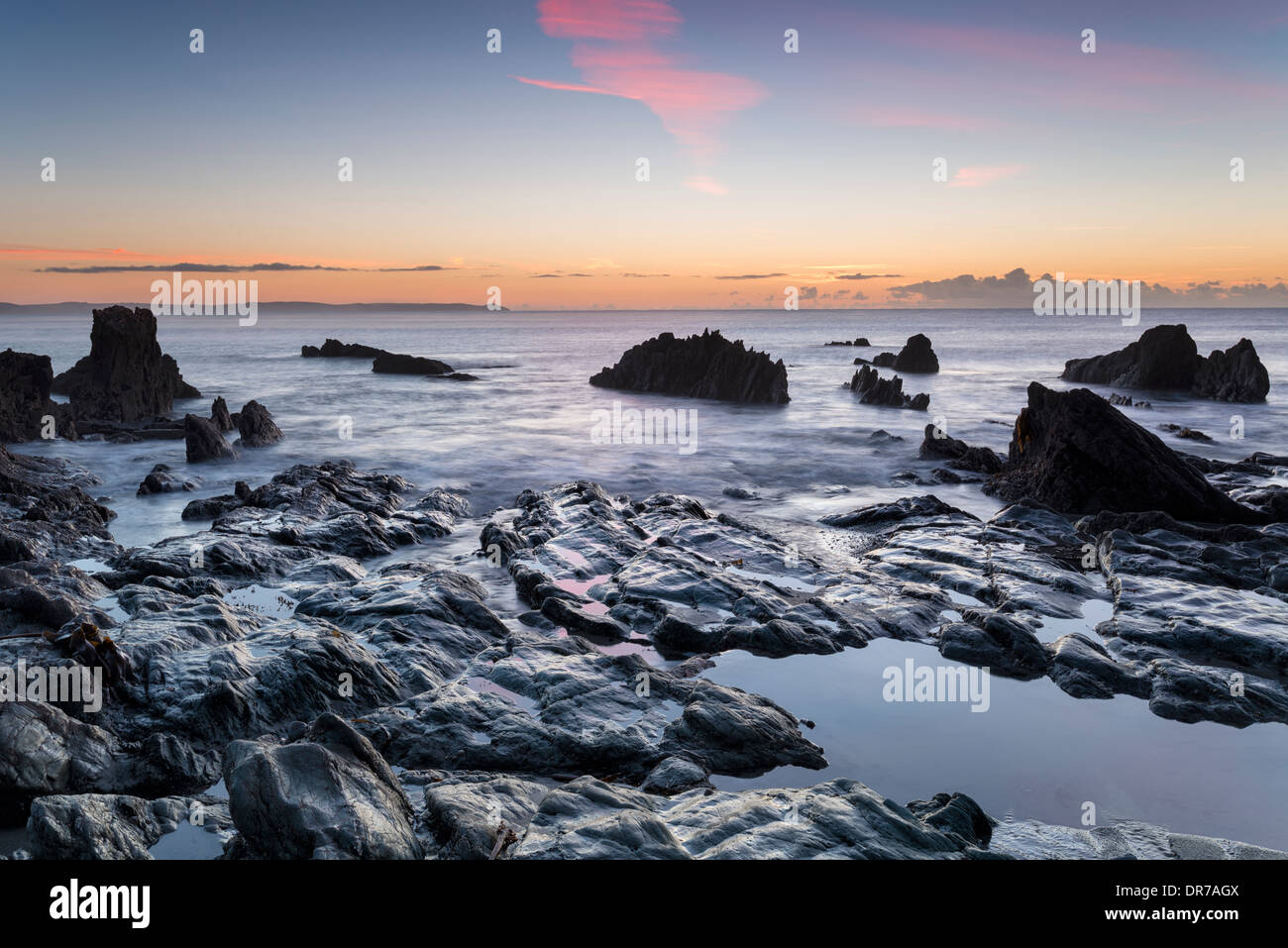 Sunrise at the beach at Looe on the south coast of Cornwall - Stock Image
