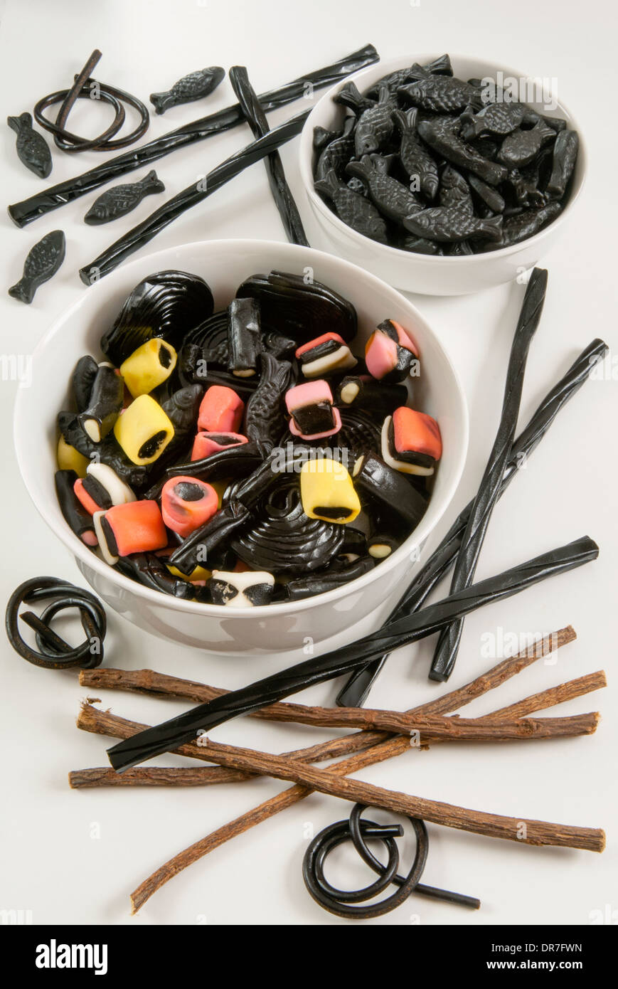 Liquorice roots and liquorice sweets - Stock Image