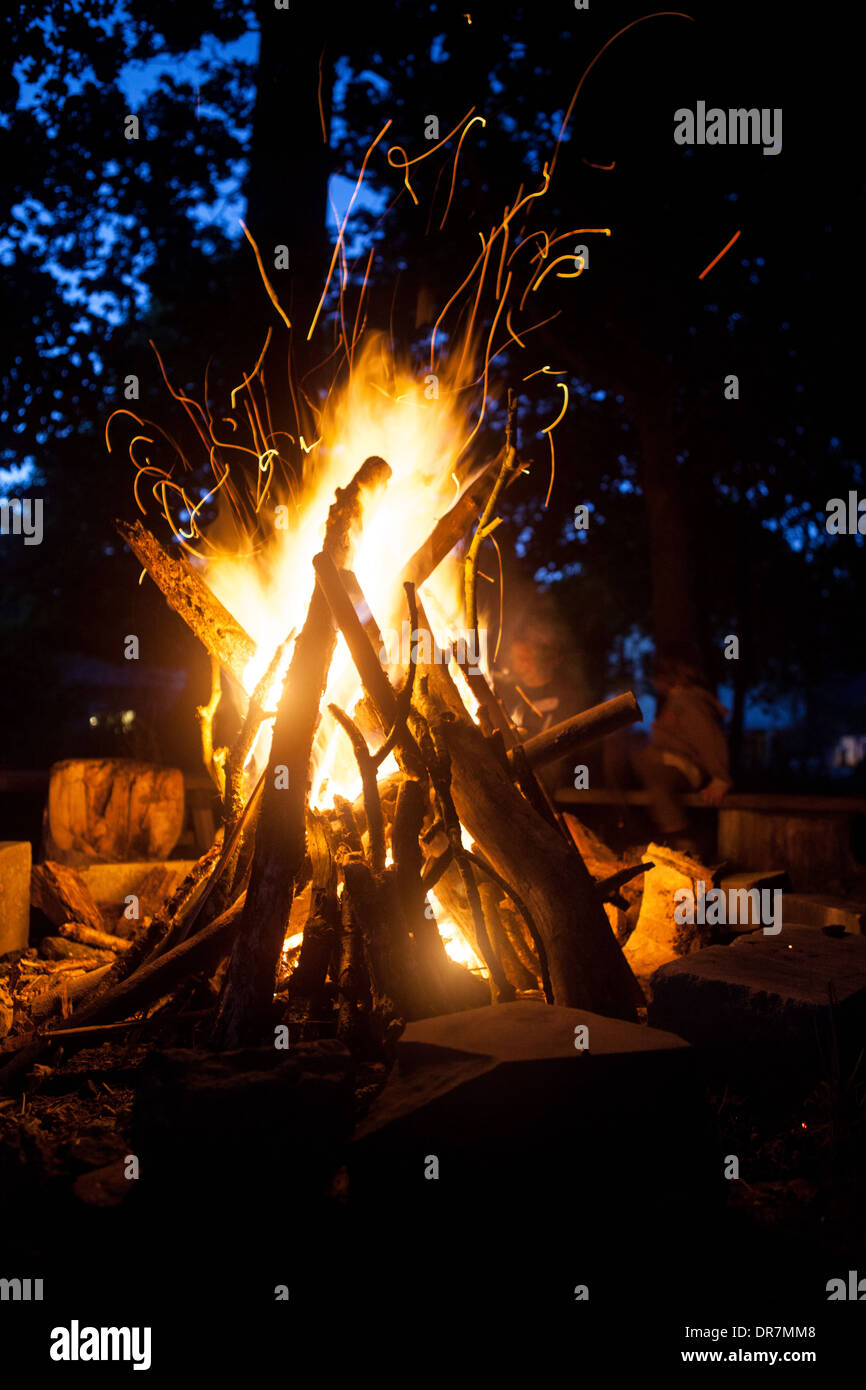bonfire, campfire, fire, sparks, children playing near fire - Stock Image