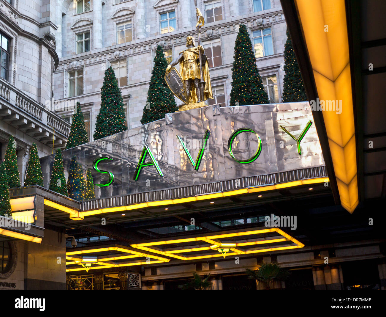 Exterior view of luxury Five-Star Savoy Hotel entrance foyer at Christmas The Strand London WC2 - Stock Image