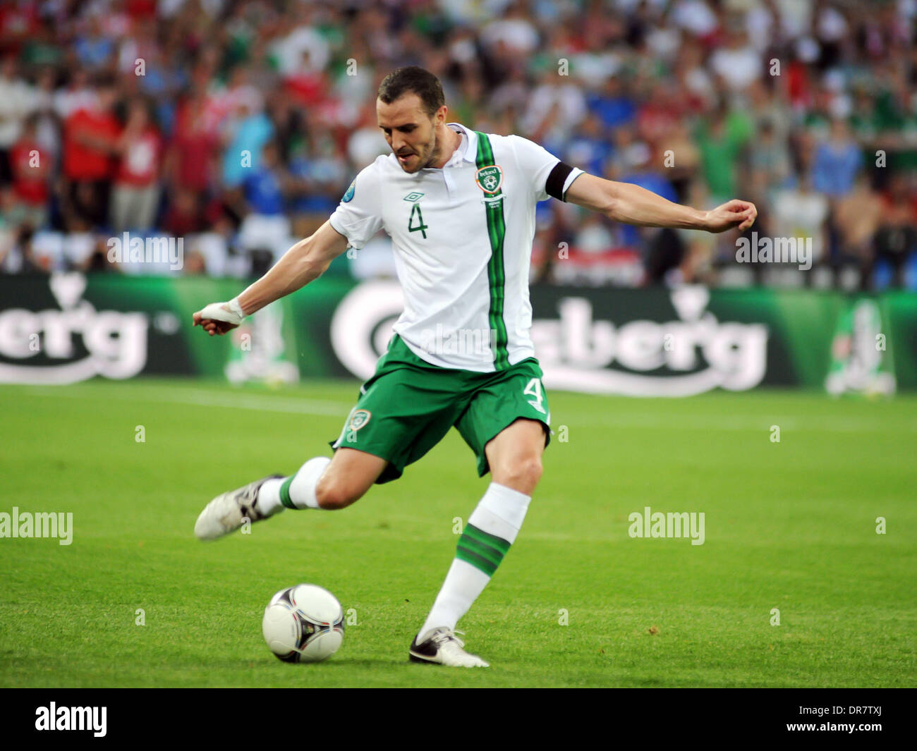 John O'Shea (Sunderland AFC) in action for Rep of Ireland during the European Championship Group C game between Italy and Ireland at the Municipal Stadium. In Poznan, Poland on June 18, 2012. Italy won the match 2-0 Poznan, Poland - 18.06.12 - Stock Image