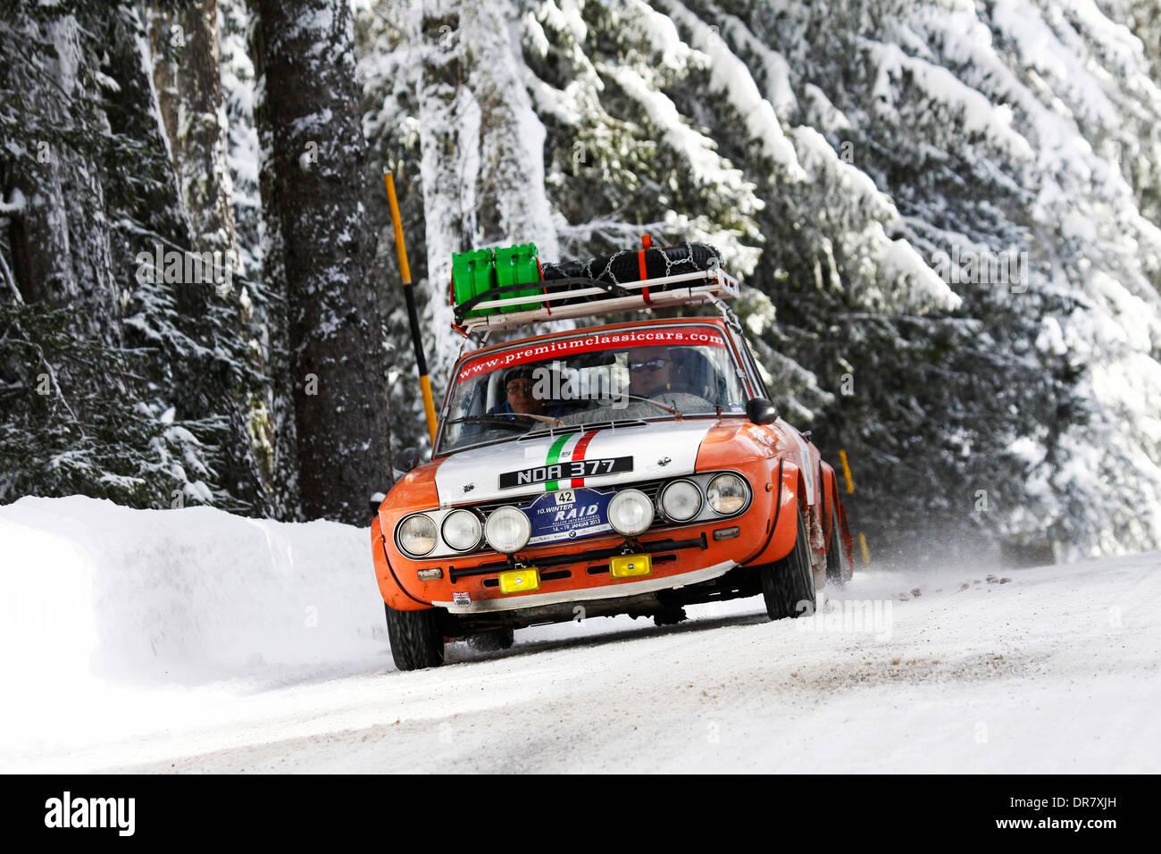 Vintage car rally, WinterRAID 2013, Lancia Fulvia, built in 1972, Engadin, Switzerland - Stock Image