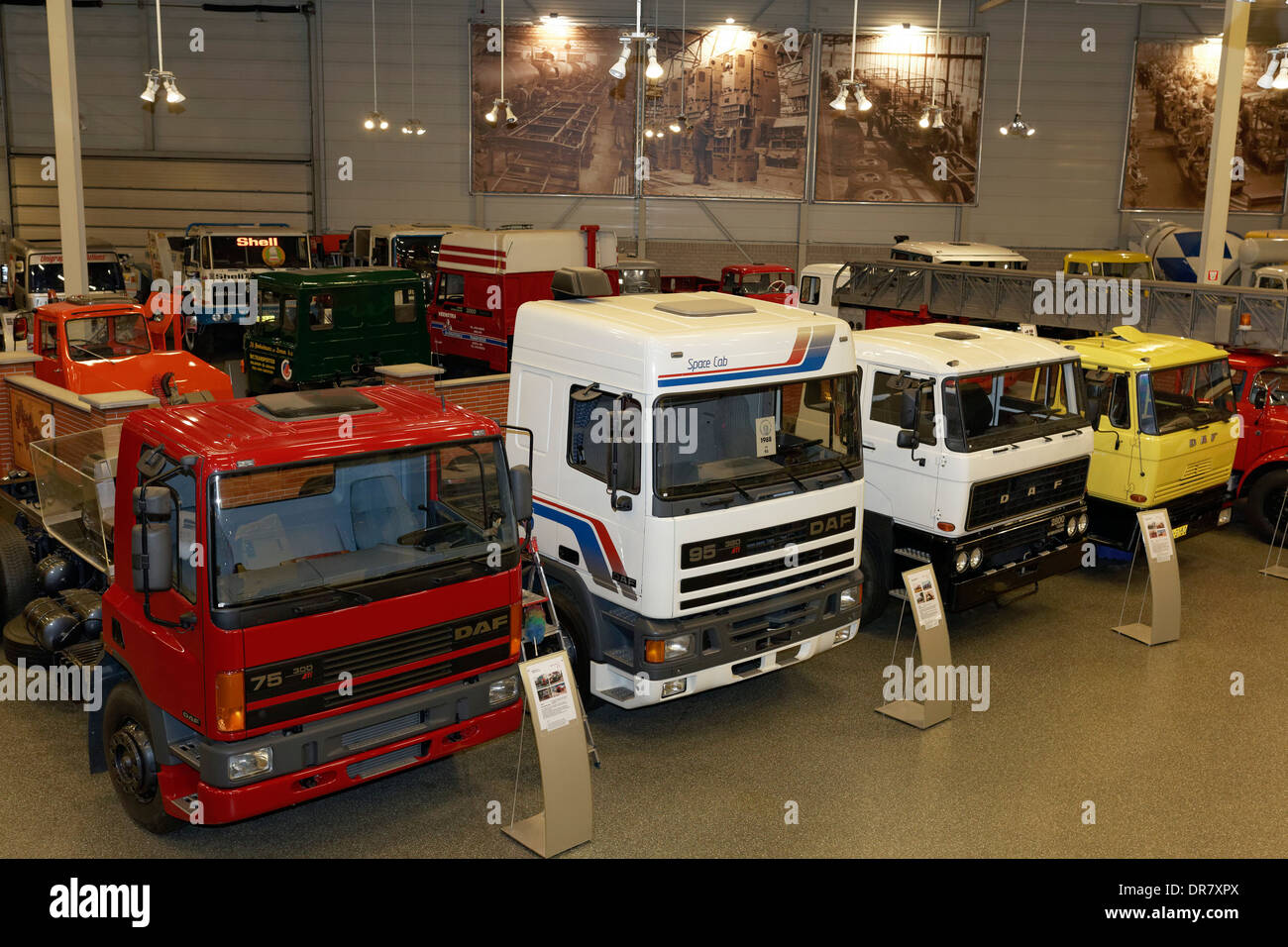 Exhibition hall with DAF trucks and semi-trailers, DAF Museum, Eindhoven, North Brabant, Netherlands - Stock Image