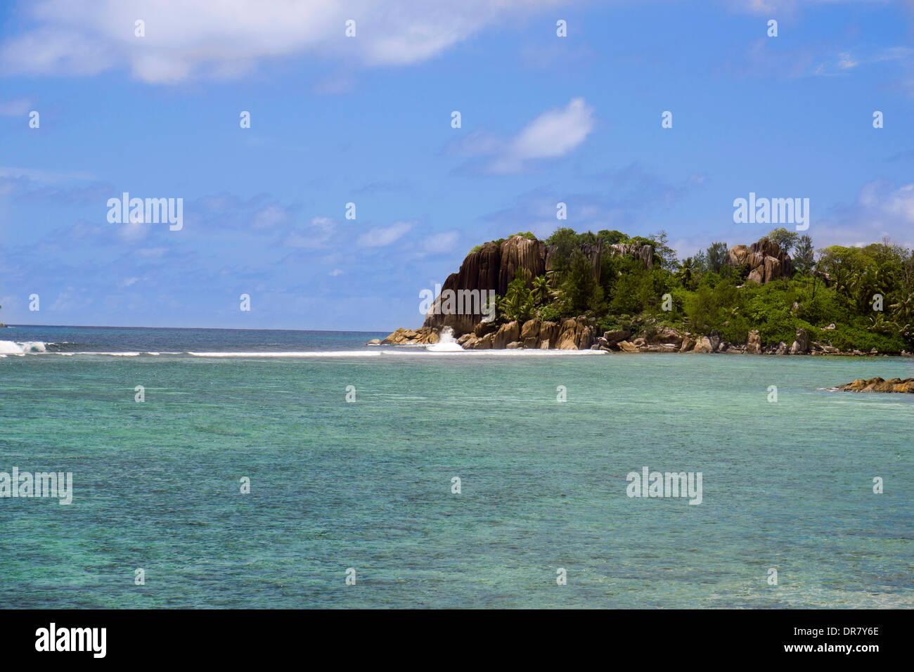 Coast formed by rocks, Mahe, Seychelles - Stock Image