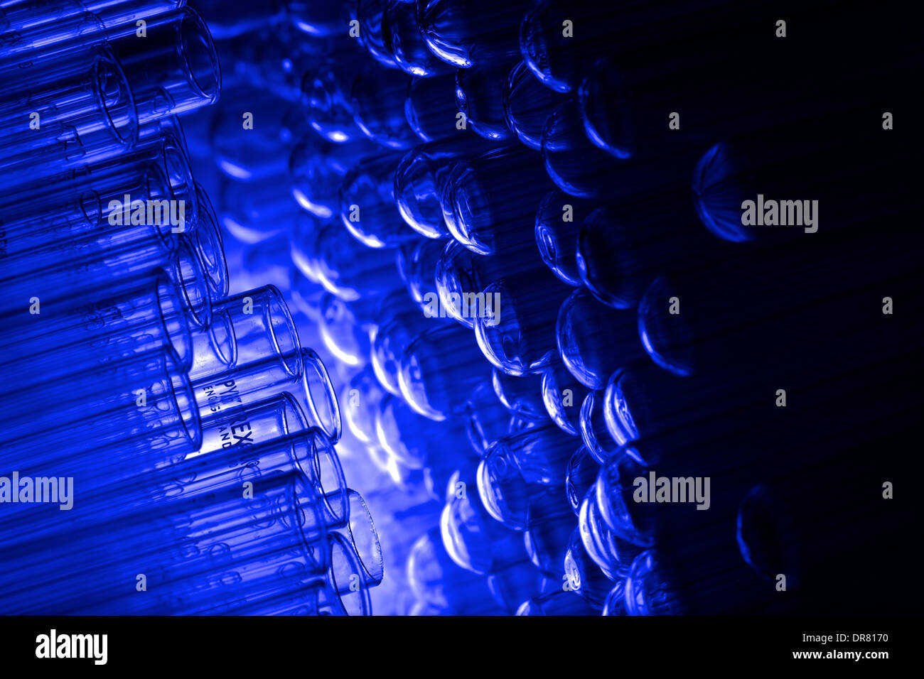 test tube bottles stacked in a drawer - Stock Image