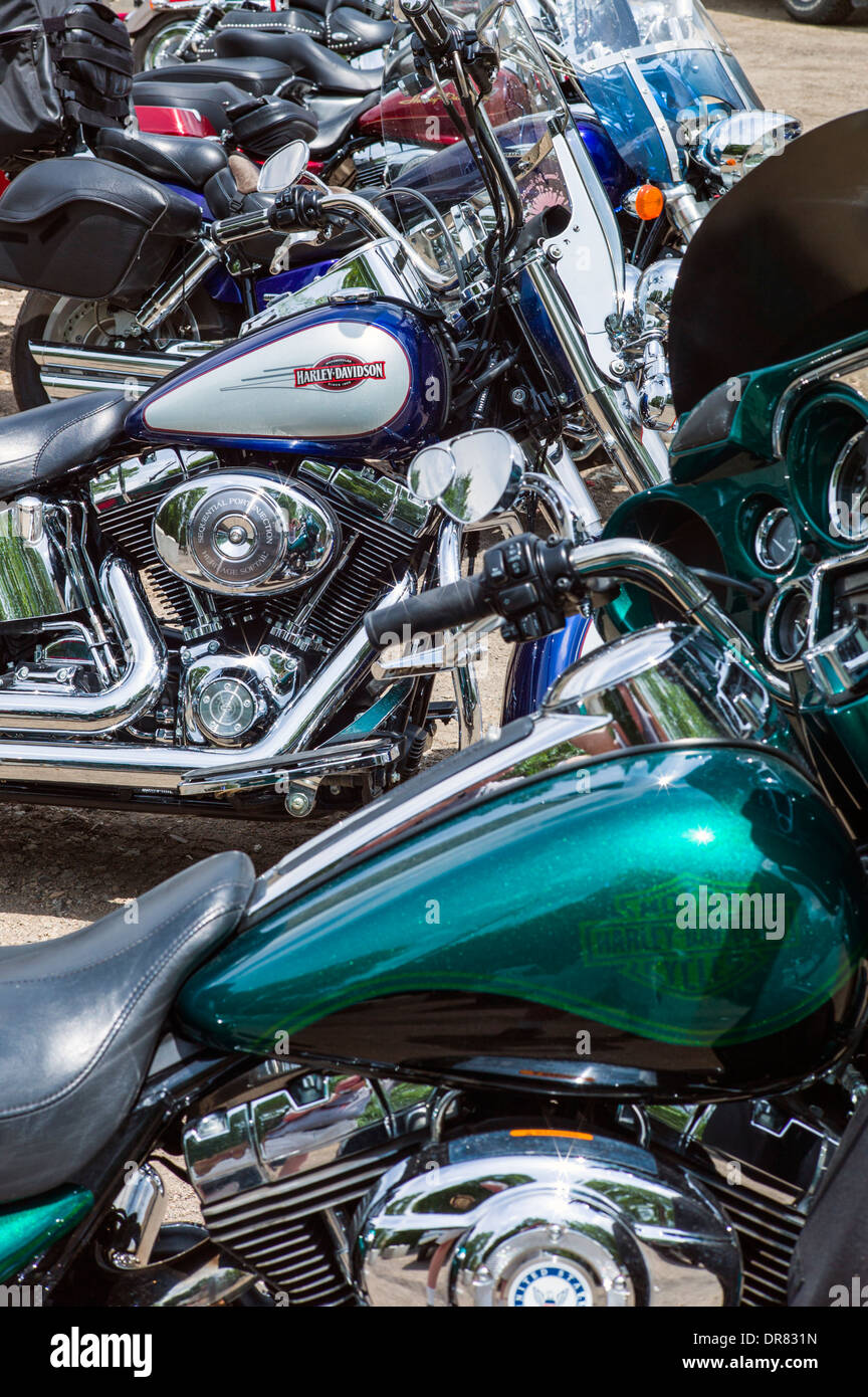 Harley Davidson motorcycles lined up on a sunny clear summer day - Stock Image