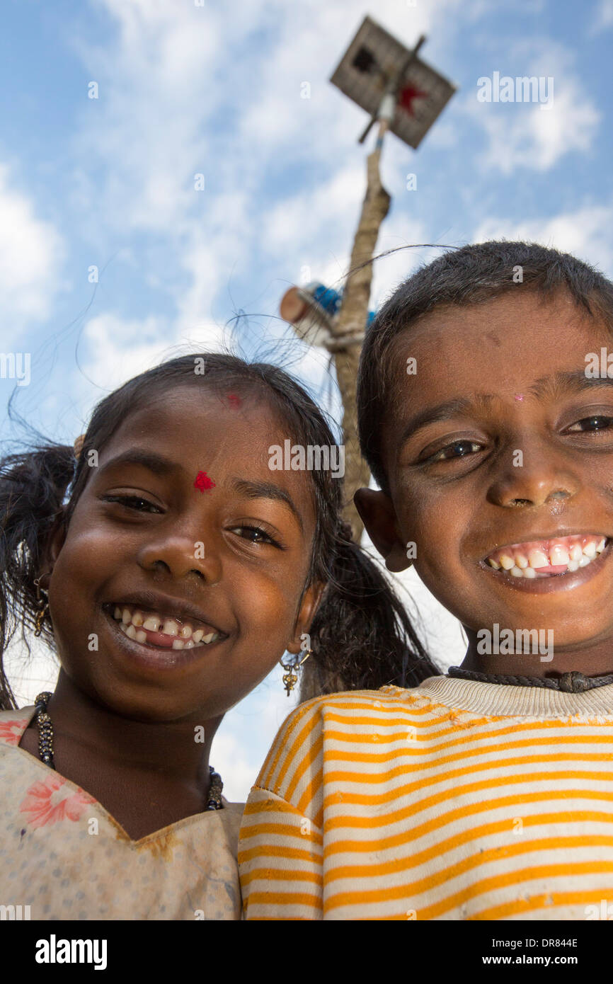 Untouchable children with a solar panel that powers their hut. - Stock Image