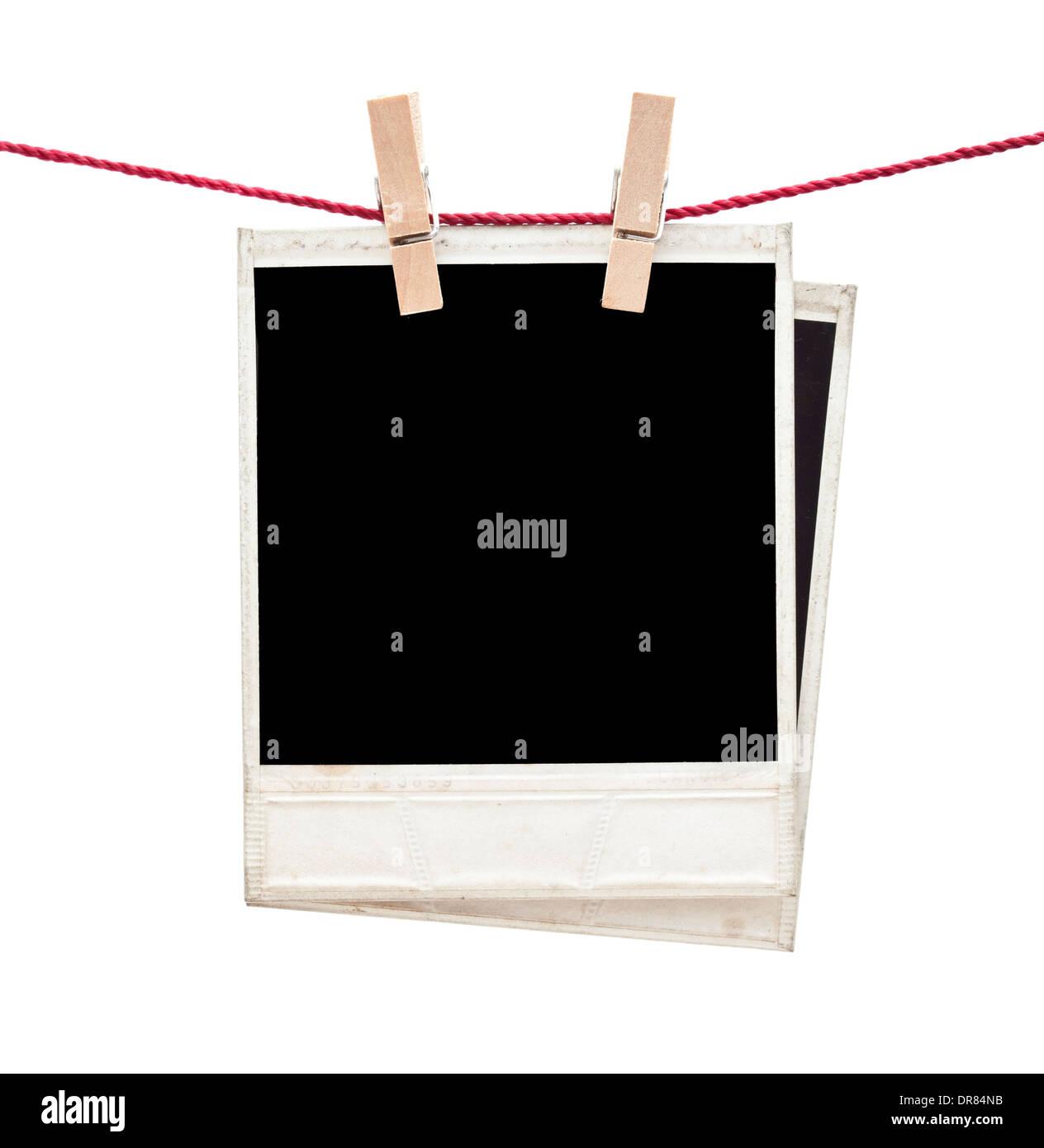 two polaroid photos hanging isolated - Stock Image
