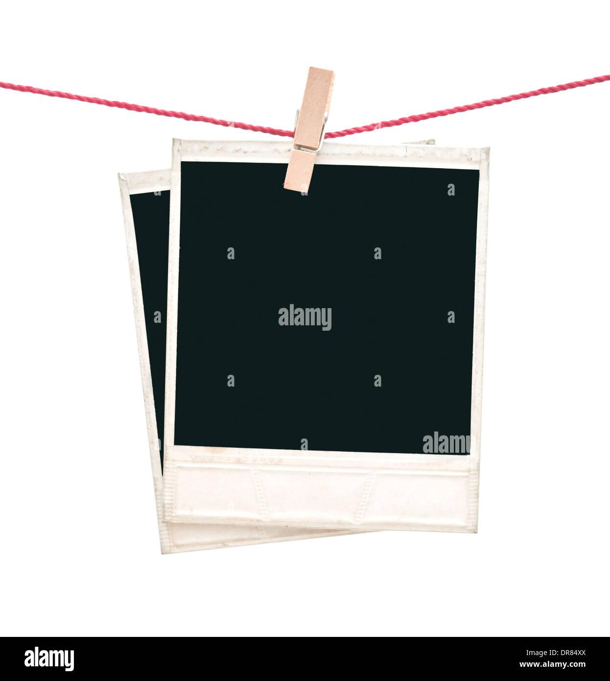 two polaroid photos hanging isolated on white - Stock Image
