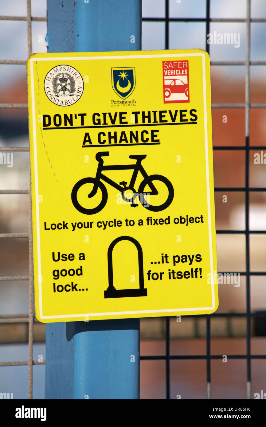 Don't give thieves a chance lock your cycle to a fixed object use a good lock it pays for itself - sign in Portsmouth - Stock Image