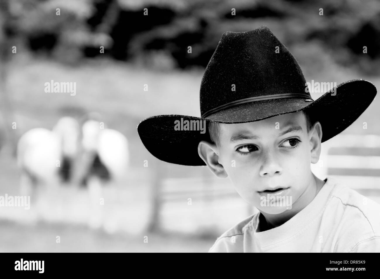 61f6fcb69a996 Young Cowboy Portrait on a Ranch Stock Photo  65948269 - Alamy