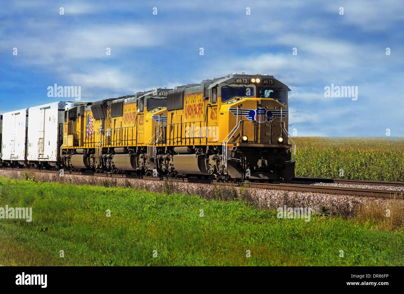 Union Pacific train on tracks near to the Lincoln Highway   near to Ashton, Illinois - Stock Image