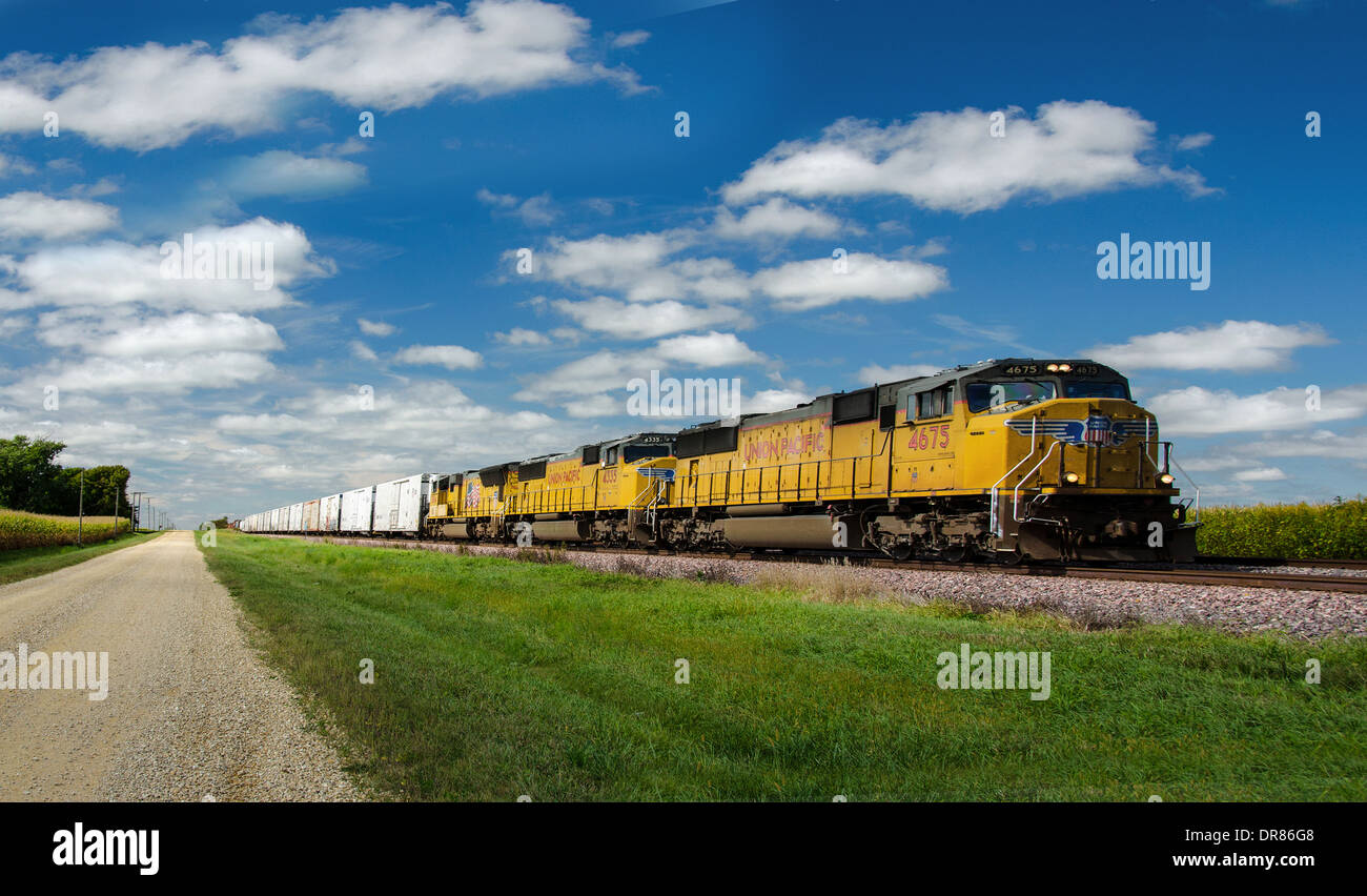 Lincoln Highway gravel road alongside the railroad tracks where the Union Pacific train is running near to Ashton, - Stock Image