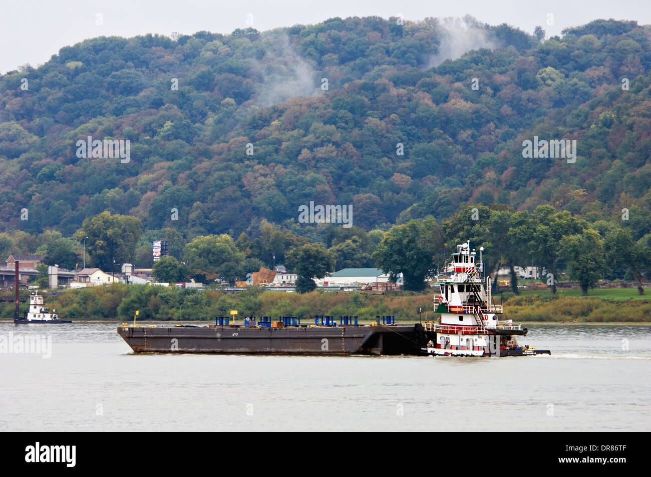 Barge on the Ohio River with Milton Kentucky on the Far Bank - Stock Image