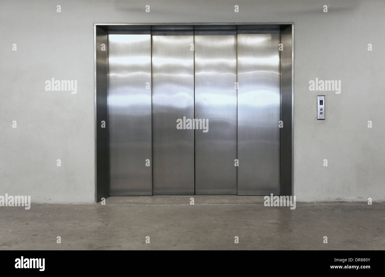 Modern elevator with closed doors - Stock Image