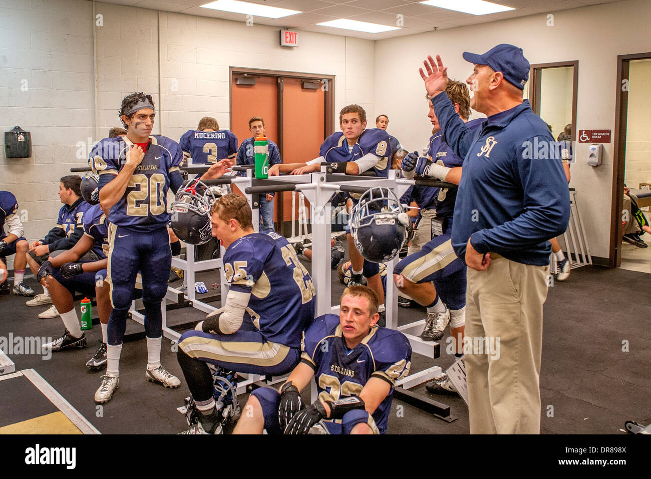 A High School Football Coach Inspires His Players In The Locker Room Stock Photo -5701