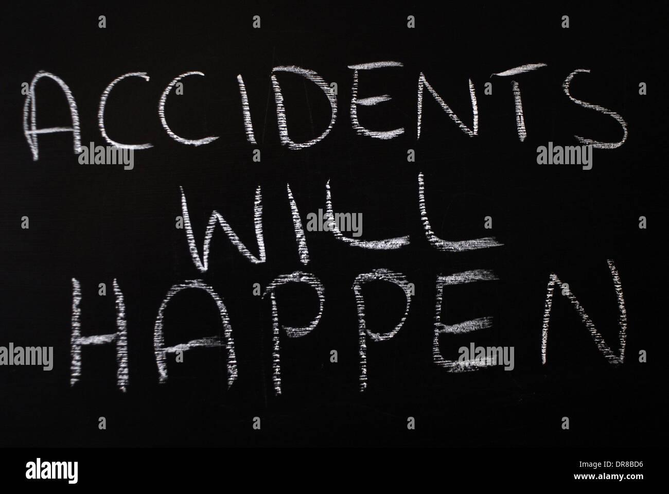 chalk writing -  accidents will happen. - words written on blackboard. - Stock Image