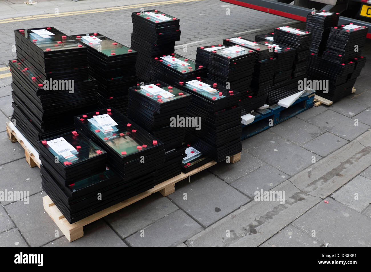 A stack of Double glazing glass replacement window panes on a pallet UK - Stock Image