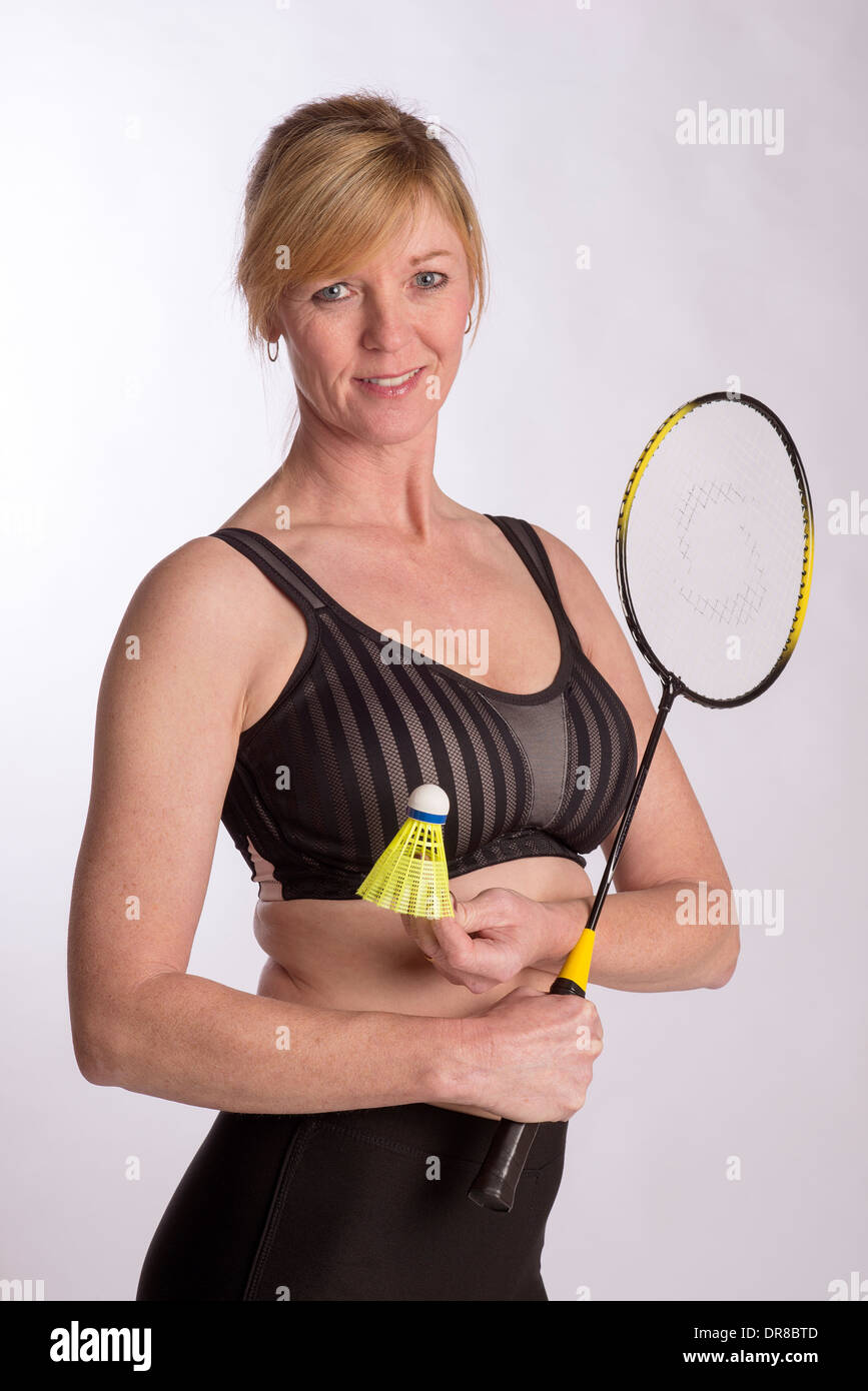 d55e7c7144d27 Badminton player wearing sports bra and lyrca shorts holding racquet -  Stock Image