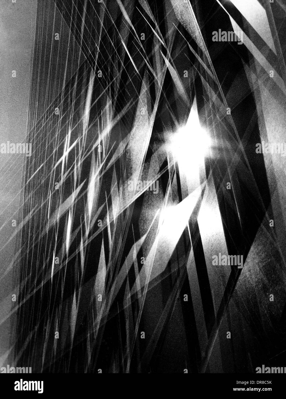 Afternoon sunlight is reflected off a New York City office building in an abstract multiple exposure. - Stock Image