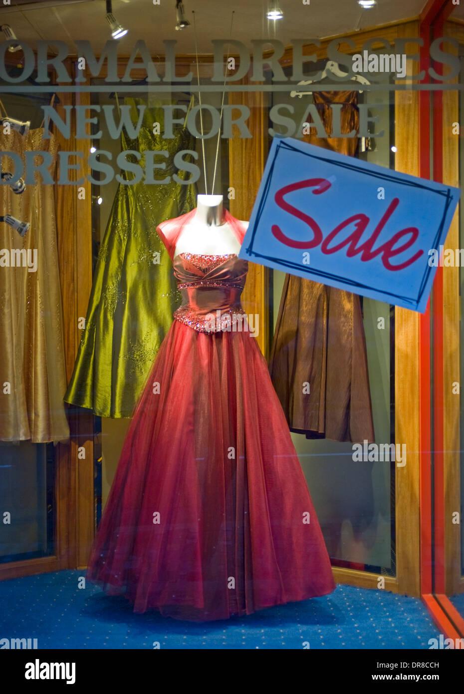 Red dress in a Belfast shop window. Stock Photo