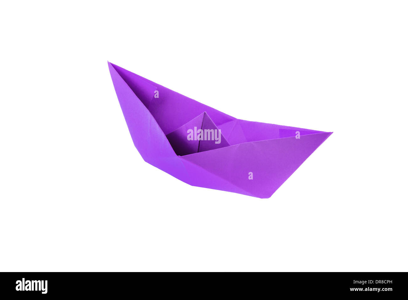 Magenta origami paper boat isolated on white - Stock Image