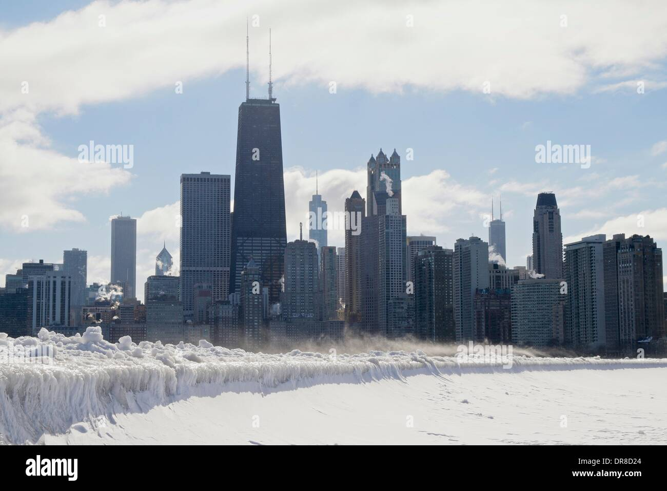 Chicago, USA. 21st January 2014.  Icicles formed by waves from the latest lake effect storm drape the seawall at Stock Photo