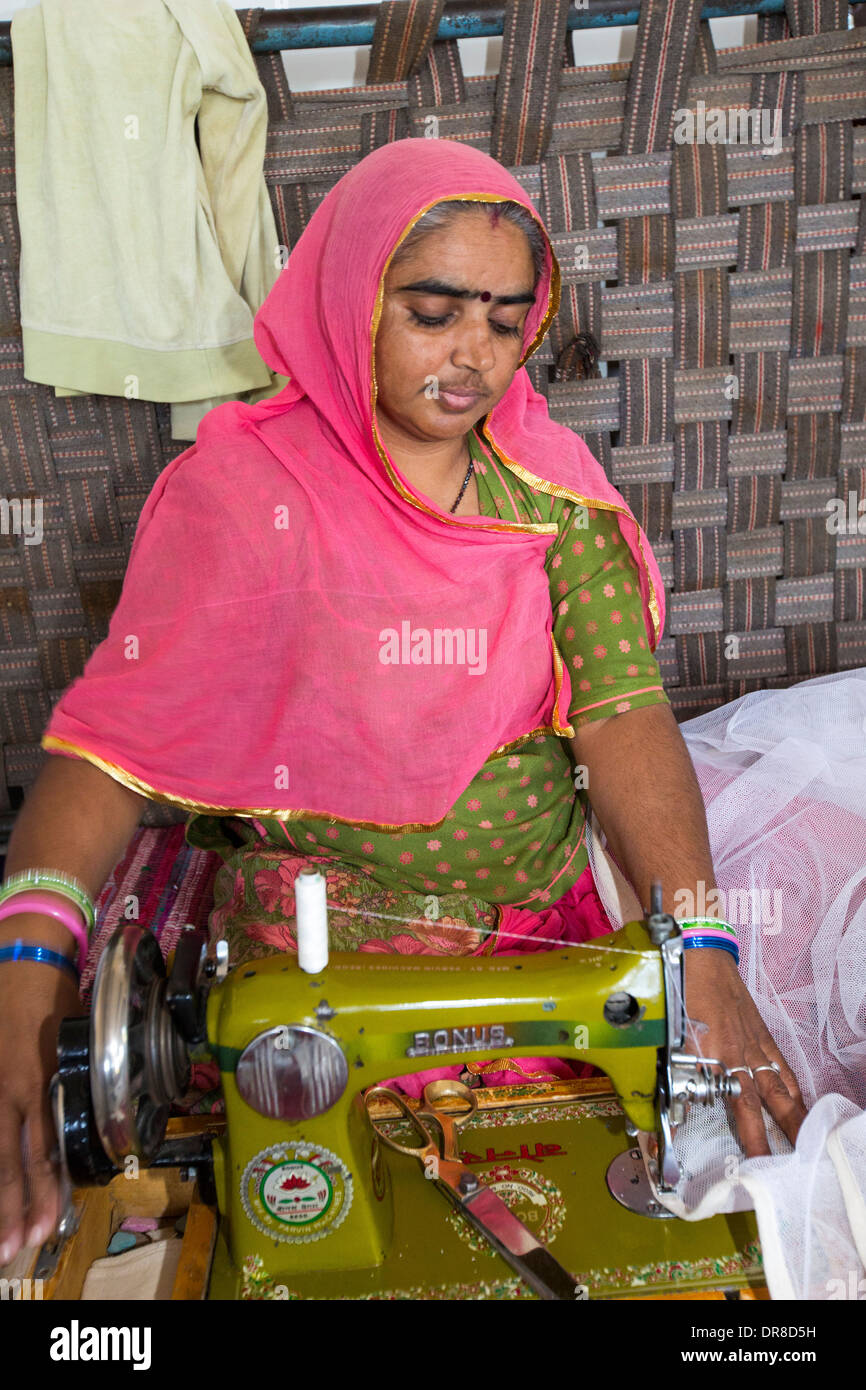 Disabled women swing garments at the Barefoot College in Tilonia, Rajasthan, India. - Stock Image