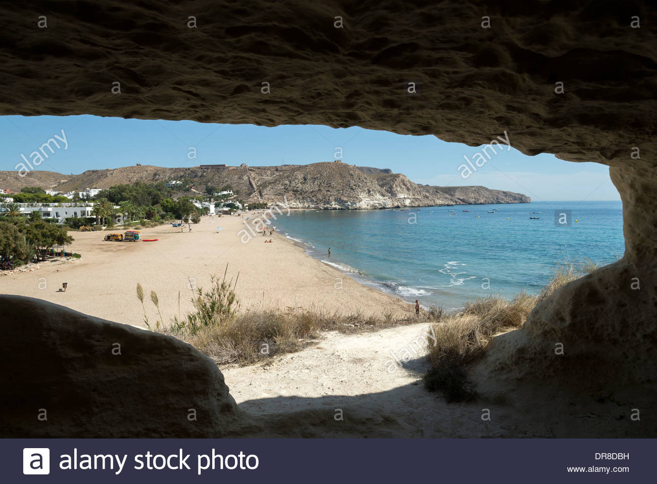 Playa Agua Amarga viewed from one of the caves in the rocks, Cabo de Gata-Nijar, Andalusia, Spain - Stock Image