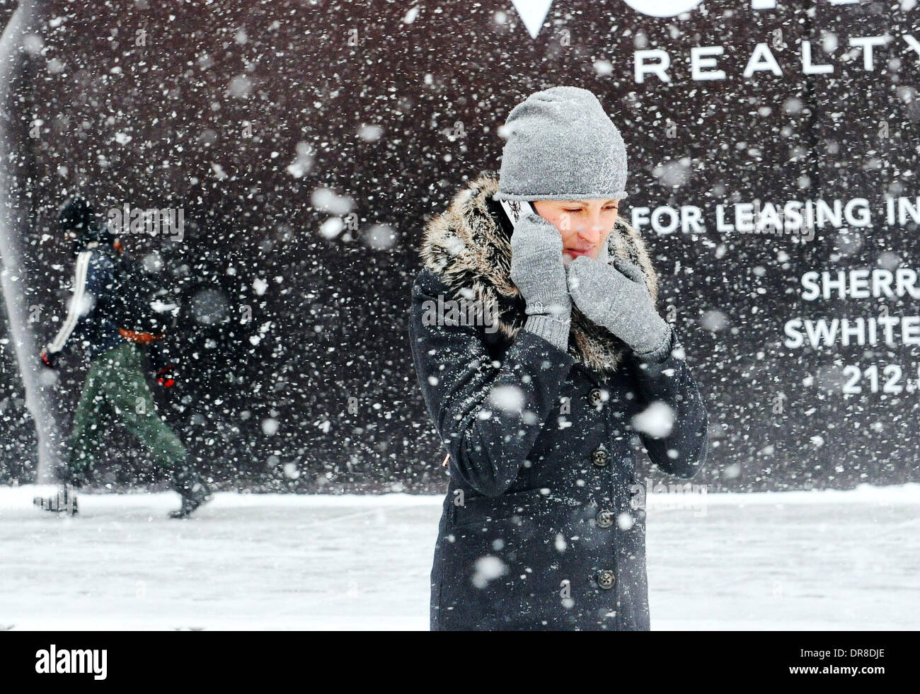 New York, NY, USA. 21st Jan, 2014. A woman walks in snowstorm at a street near the Times Square in New York City, Stock Photo